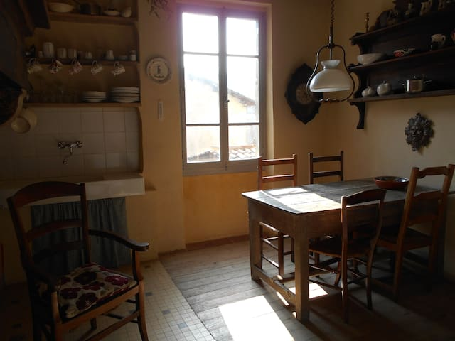 Dining area in the well equipped kitchen, there is a dishwasher as well as the traditional french sink!