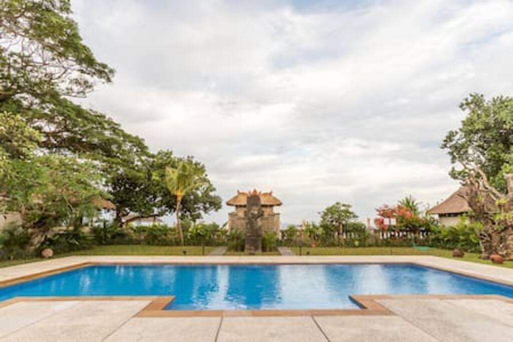 Looking east: Foreground 11-meter pool, beach & Bali Sea on Indian Ocean beyond gardens.