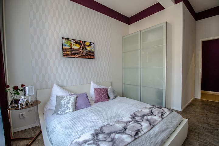 King size bed, bedside table and a spacious wardrobe  wiin the third bedroom