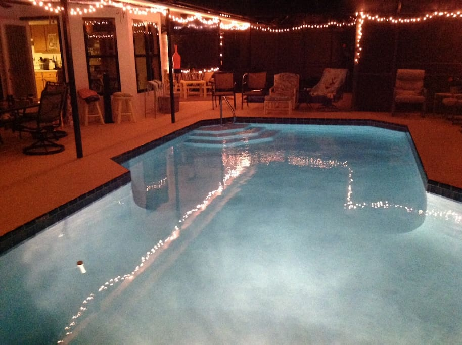 lights reflecting off the pool at night