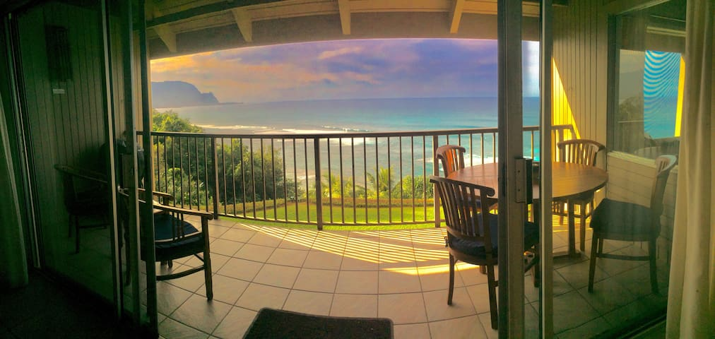 Outdoor lanai (deck) just outside from the living area. Includes teak dining table and electric BBQ.