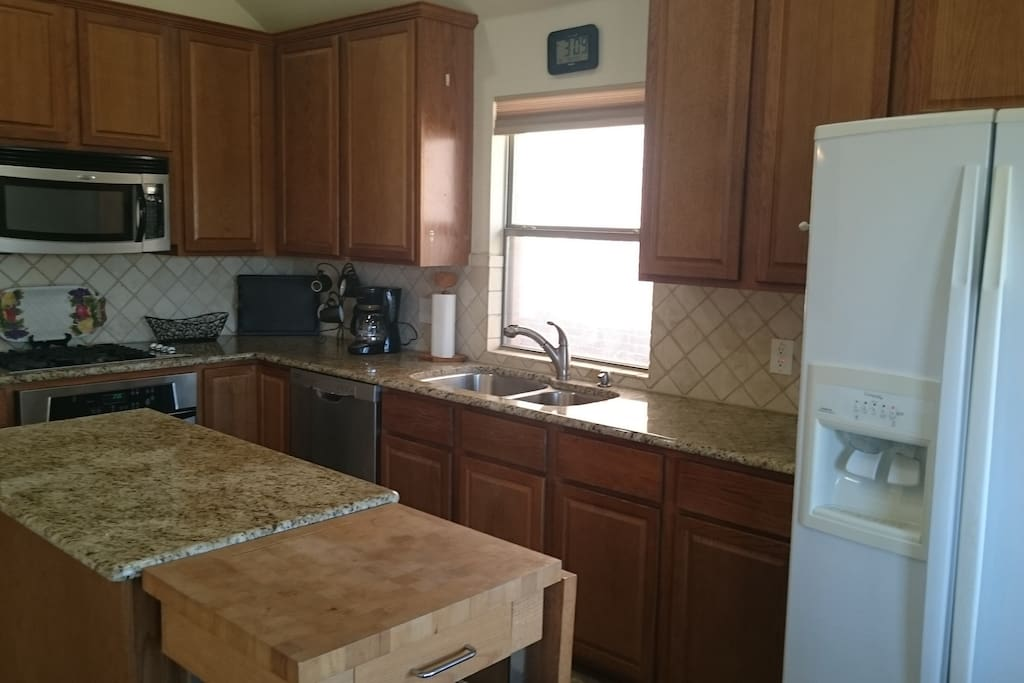 Kitchen with granite countertops and plenty of counter space