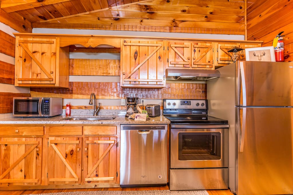 Stocked Kitchen With Stainless Appliances And Granite Counter Tops!