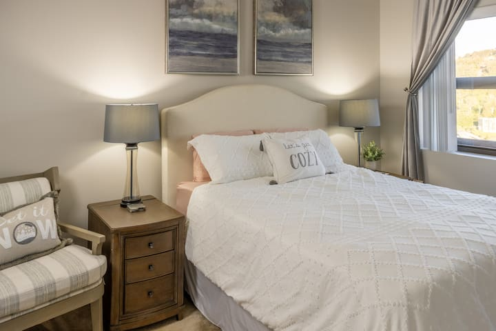 Large bedroom with queen bed and a view of the ski slopes