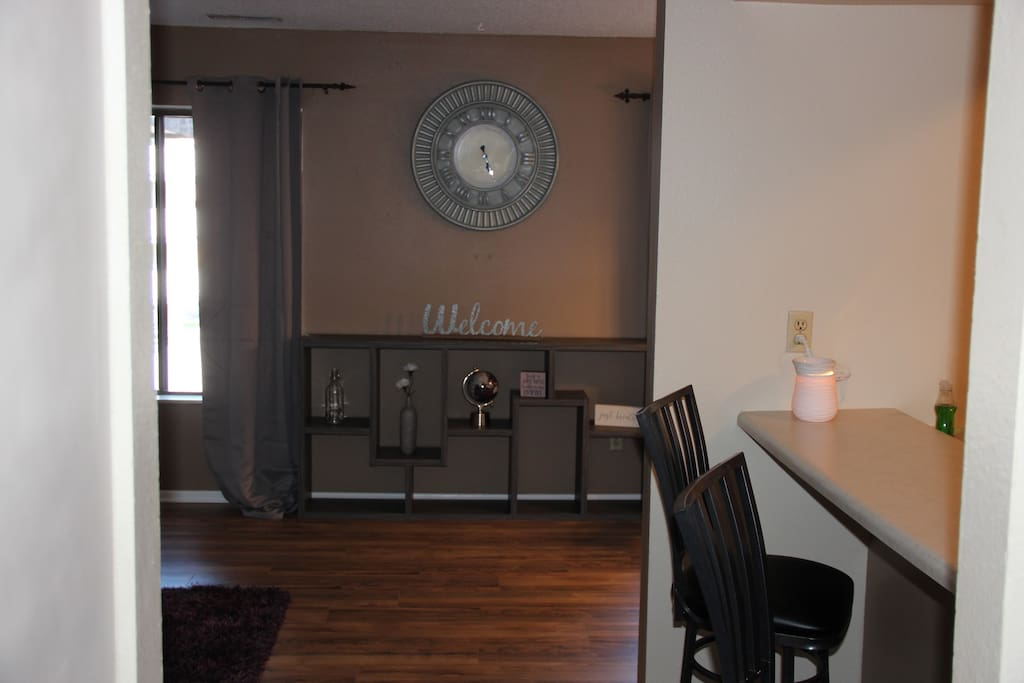 "As you come in the main door, you see us ""WELCOMING YOU"". There is a powder room on your right across from a set of stairs leading to the 2 bedrooms and full bath."