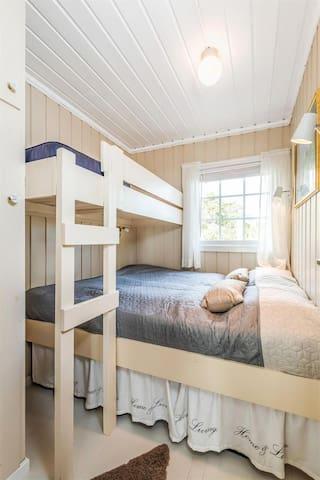 Soverom med tre sengeplasser