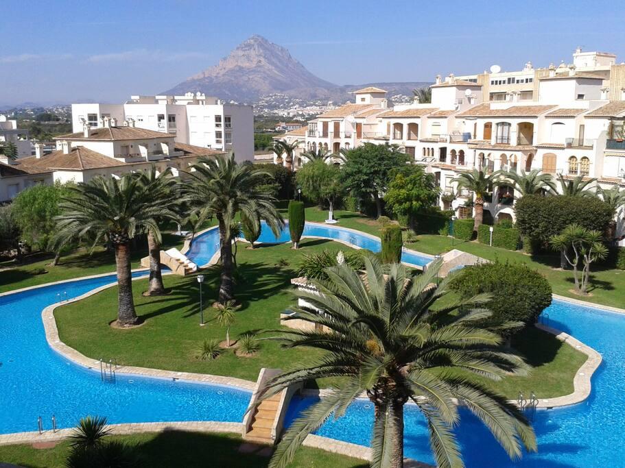 Beautiful gardens and pool surrounding an island