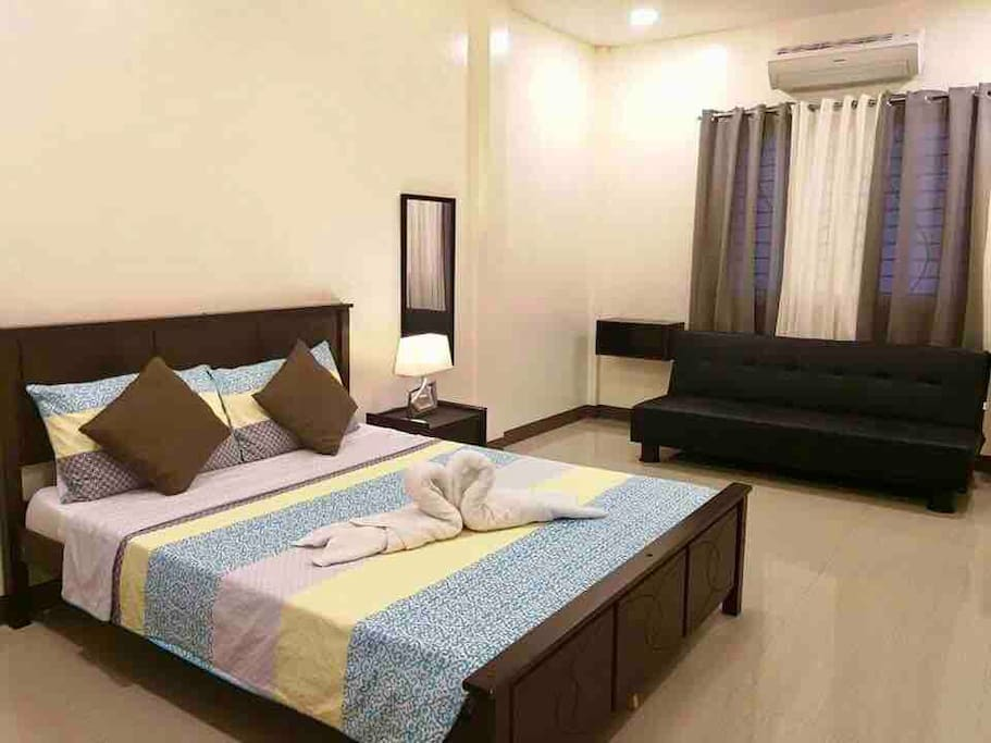 Airconditioned master bedroom with Queen bed, sofa bed and wardrobe.