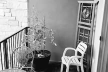 Comfortable patio balcony with table and chairs