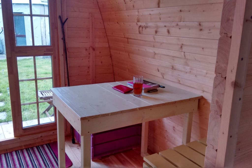 Dining table. Living area furniture can be removed to fit in camp bed for a third person