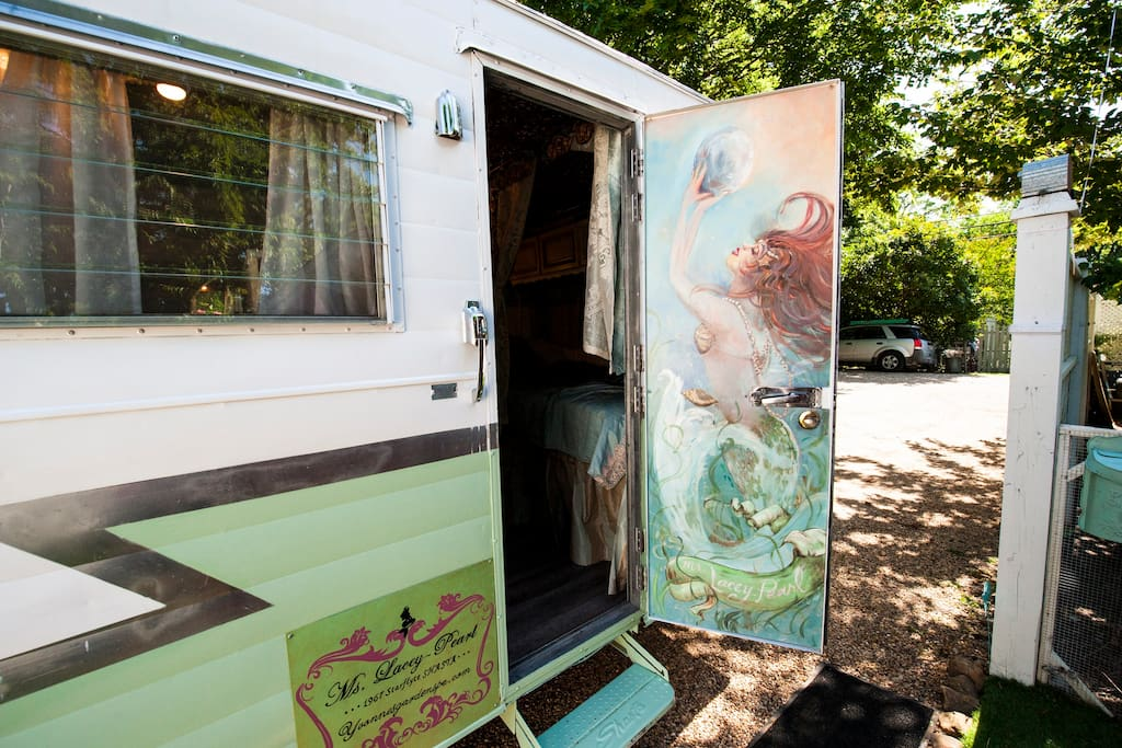 """A mural of Ms. Lacey-Pearl greets you!  Come visit a 5 star """"MERMAID's LAIR"""" themed vintage trailer experience!"""