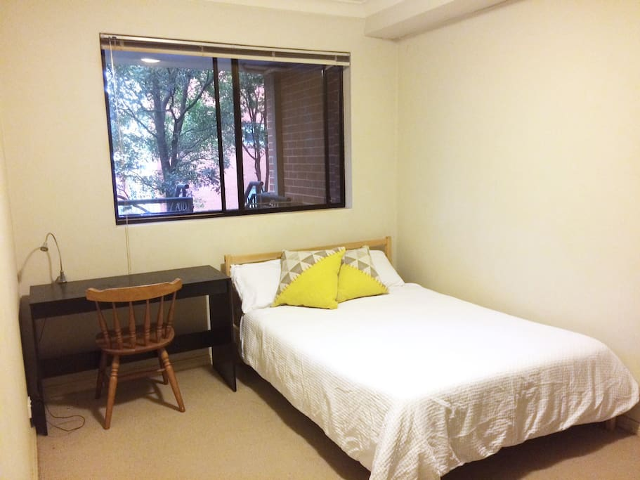 Bedroom with double bed, desk and chair