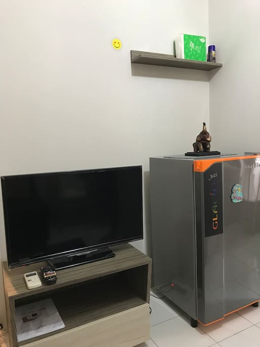 You can watch TV and storage some food; fruits and drinks into refrigerator