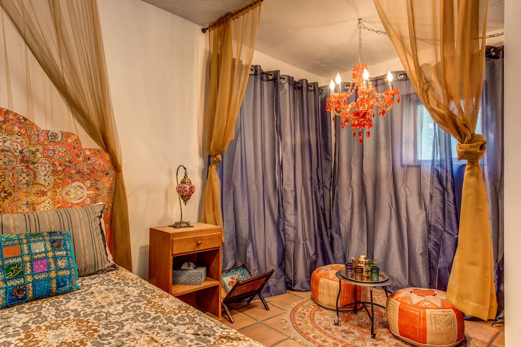 Romantic curtains line the bedroom area and tea lounge.