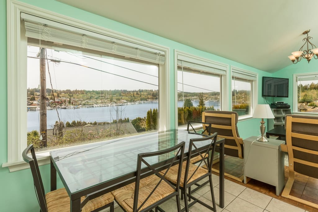 Enjoy Harbor views while eating breakfast at the dining table with seating for four.