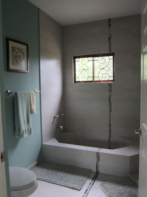 Master bath with   separate bath and shower