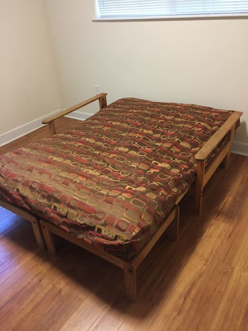 Futon folds out into queen bed. Blow up queen bed also available.