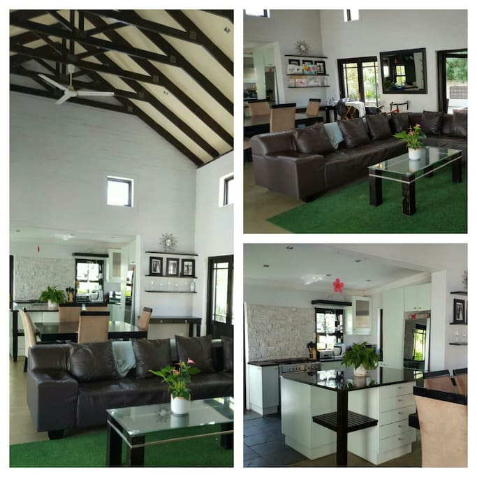 Open plan Living space with 8 seater Dining Table,  large TV and outdoor entertainment area