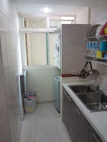 Kitchen (with clothes washer and dryer)