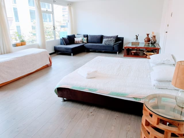 5. Large Bedroom with Comfy Sofa!