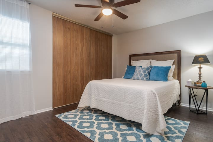 Second/Guest Bedroom with a queen size bed