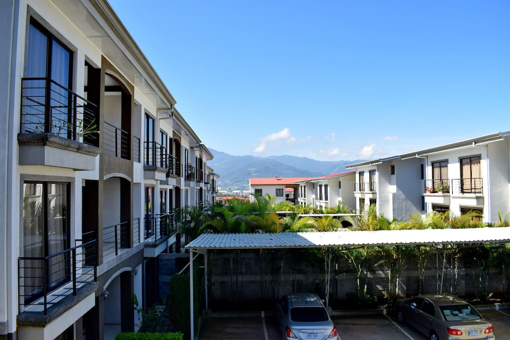 Your view from the dining area of the three bedroom (four bed) condo. Those are the green Escazu mountains to the south.