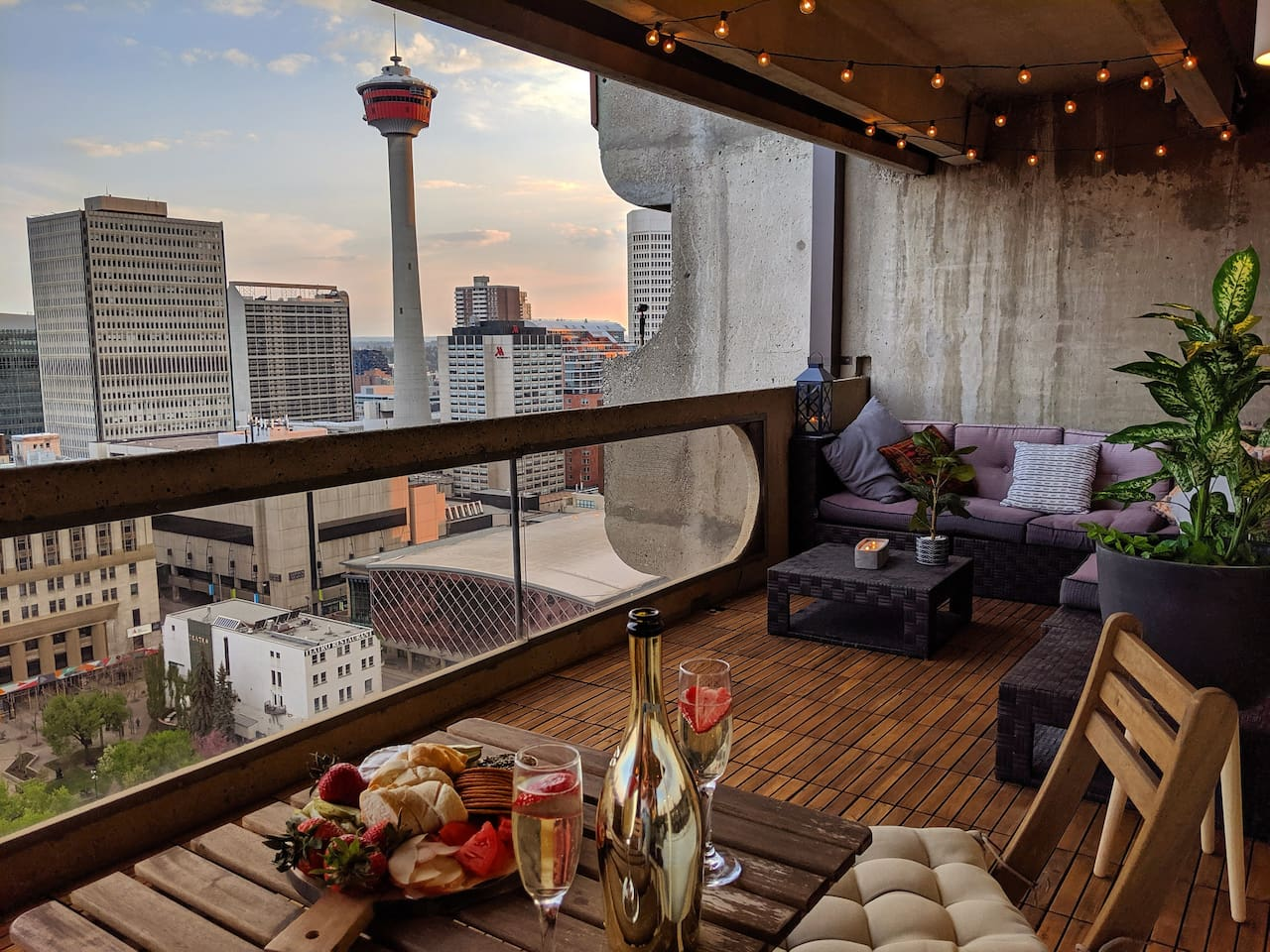 The spacious 270 square foot balcony overlooks Calgary Tower, Saddledome and the Bow River