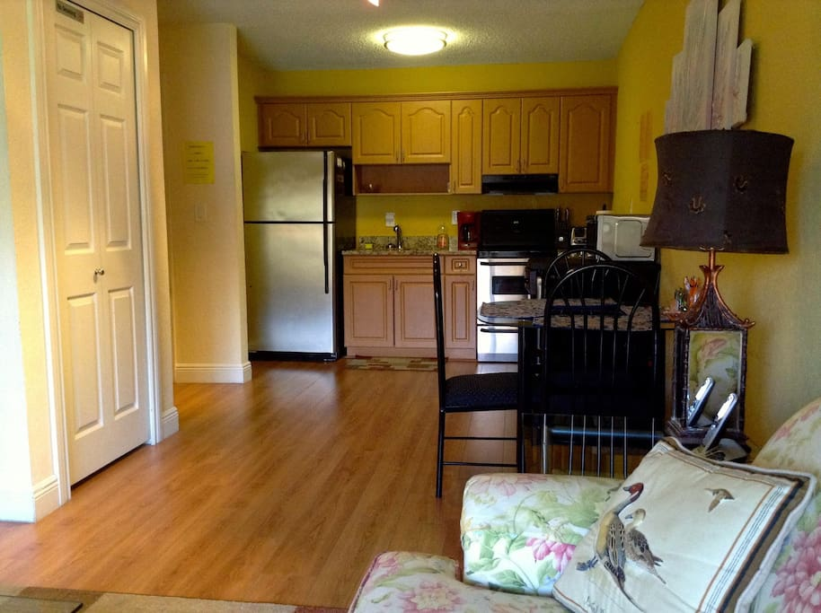 Fully equipped kitchen with granite counter top.  Living room tastefully furnished. Airbed/sleeping sofa also provided.