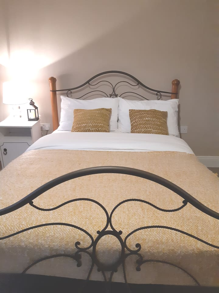 Comfortable double bed with mattress topper for extra snugness