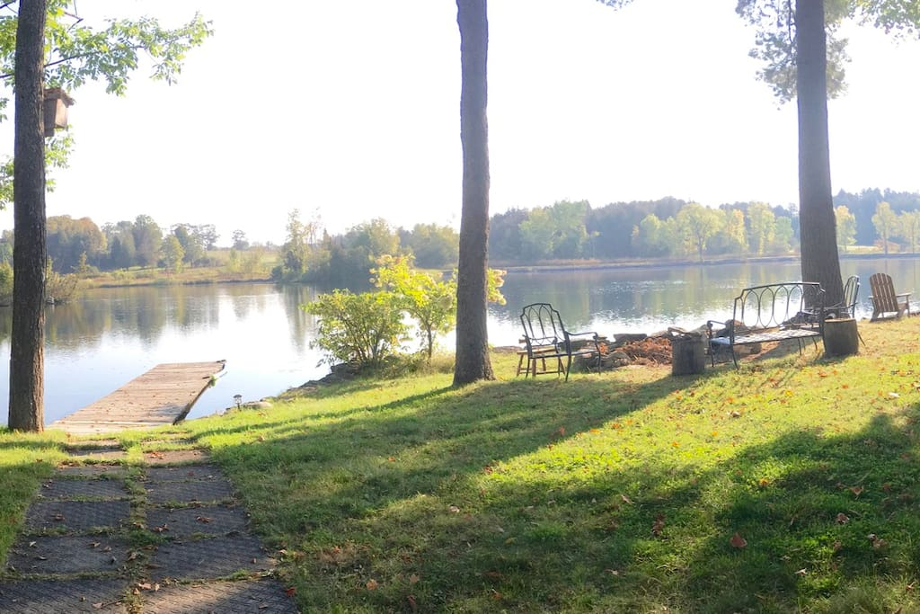 Over a 100' wide level lot with massive Bonfire Pit and plenty of seating