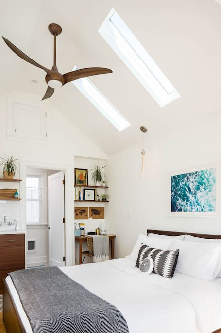 Vaulted ceilings make the 240sf studio feel airy and spacious.