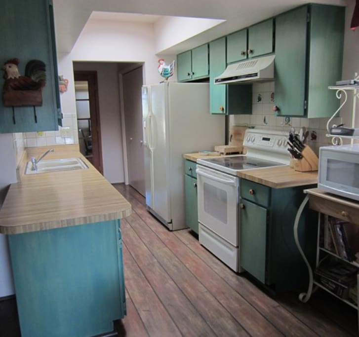 Galley turquoise Kitchen. All the comforts of home.