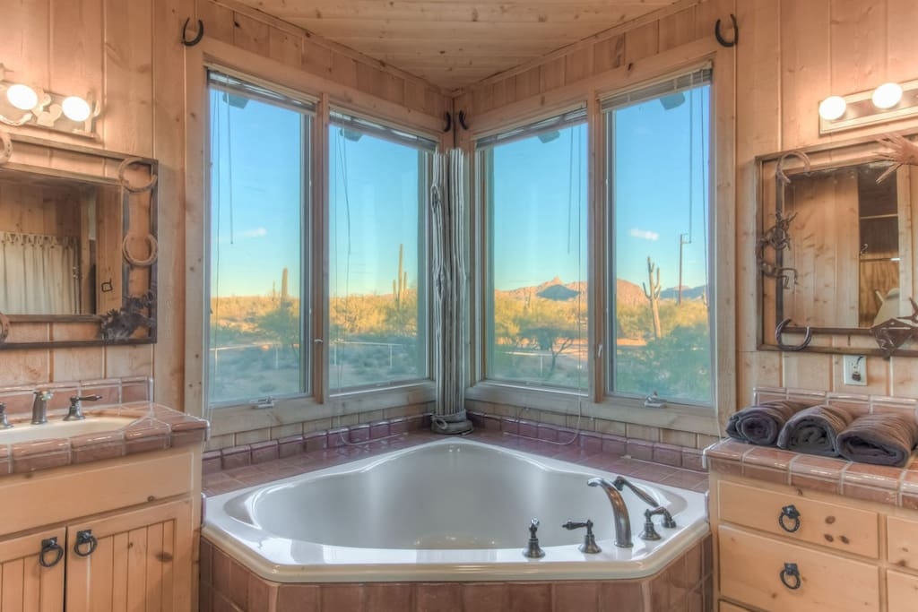 Imagine looking out at the painted landscapes while sitting in the tub.