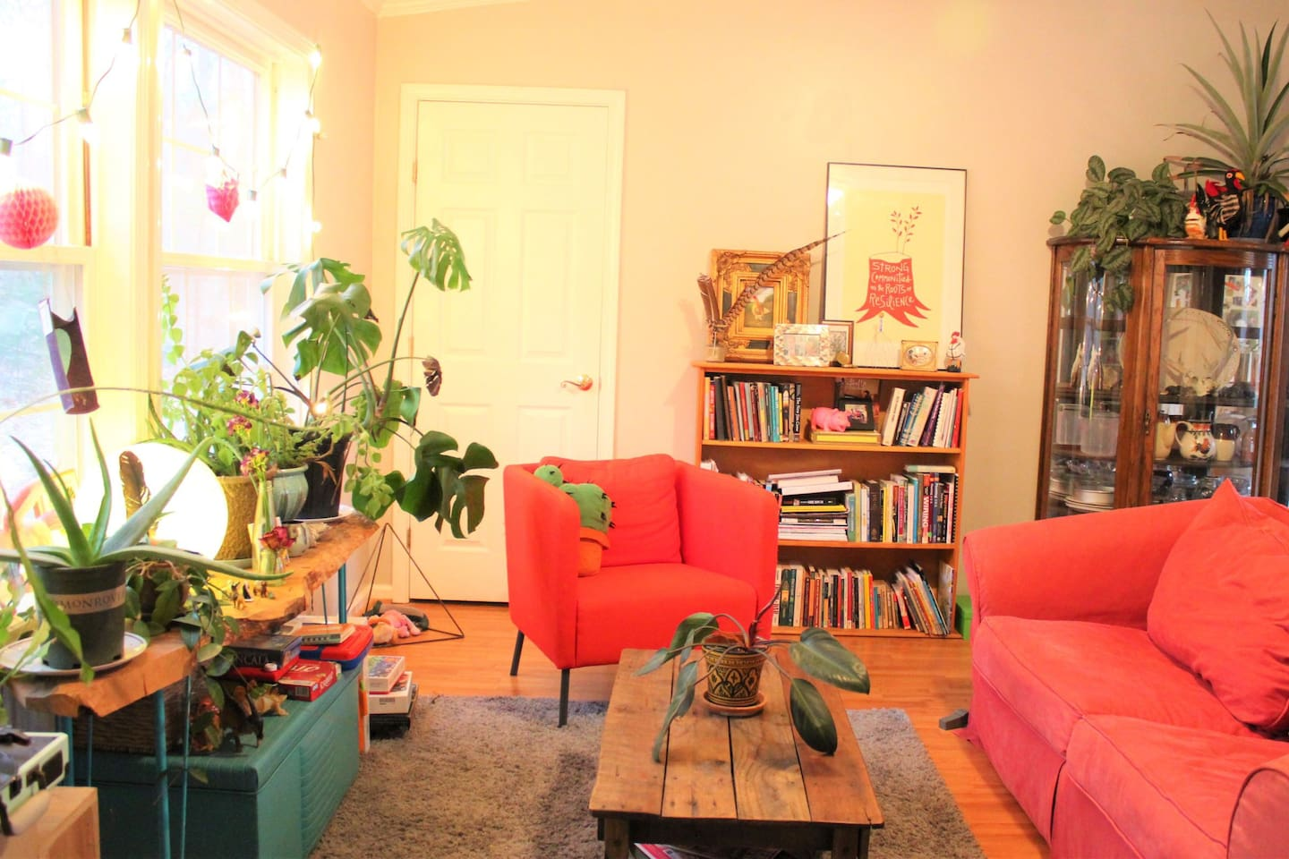 The communal living room, with a record player, board game, and a small library for guests to enjoy