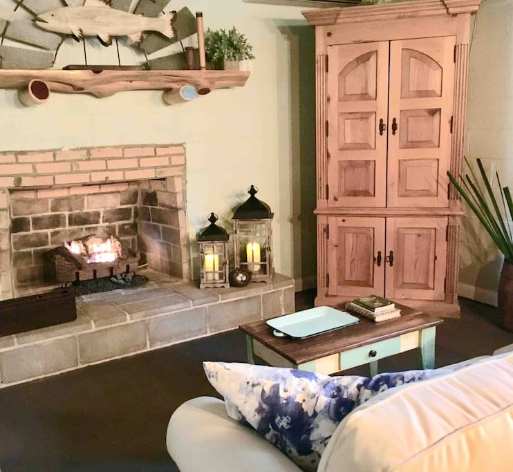 The living room features a masonry fireplace with gas logs. The TV, DVD player, a wide variety of movies, and board games are provided for rainy day entertainment or if you get tired of the peace and quiet.