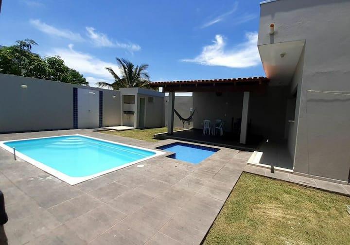 Casa com piscina próximo à praia para suas férias