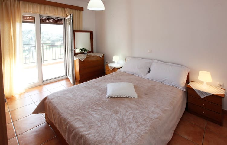 Bedroom 2 with double bed and olive grove view