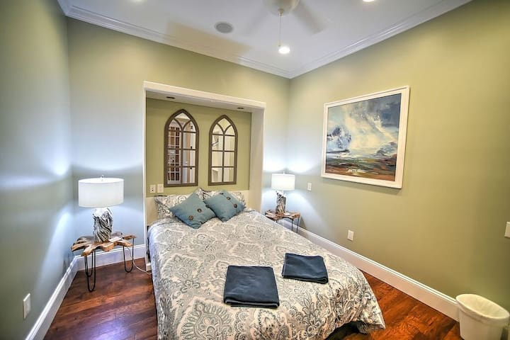 Another newly renovated bedroom downstairs, with queen size bed