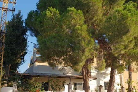 Two Bedroom House with terrace and garden in Koura