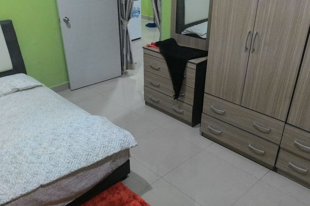 Bedroom; 1. Queen bed 2. Cupboards (inside are extra pillows and thin mattress) 3. Mirror 4. Air-cond