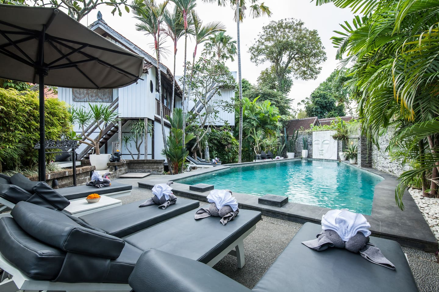 Private swimming pool of Villa Sembunyi during the day
