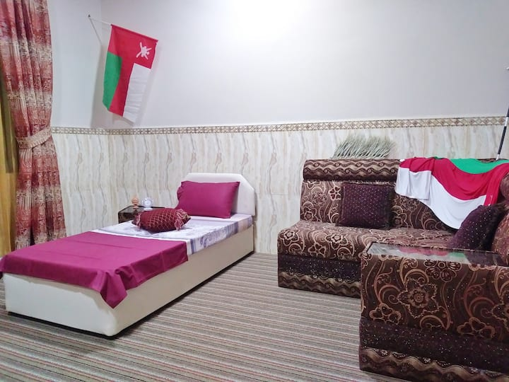 Room with single bed front the beach