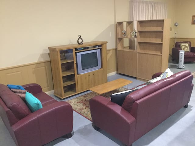 Comfortable lounge and flat screen TV with DVD
