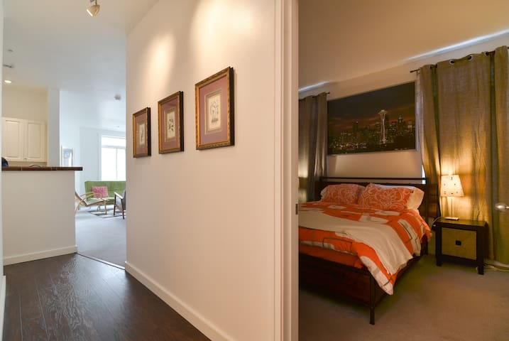 Perspective from hallway into the master bedroom