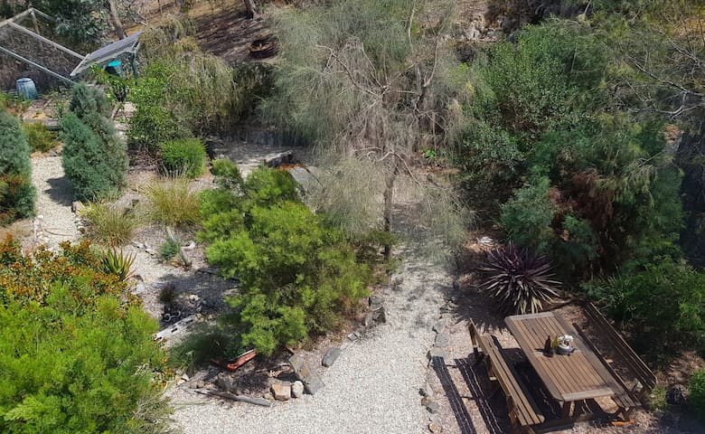 Native gardens with meandering paths to cozy fire pits and relaxing swing seats.