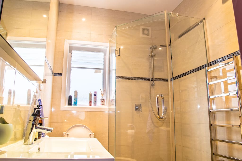 Private modern bathroom (shared with maximum 2 other guests) with heated towel rails and continuous hot water