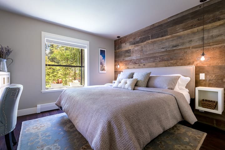 Master bedroom offers a plush Casper King-size bed, luxurious linens, blankets, pillows and guest robes.