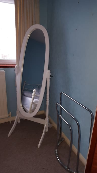 Full length mirror and three tier towel drying rack