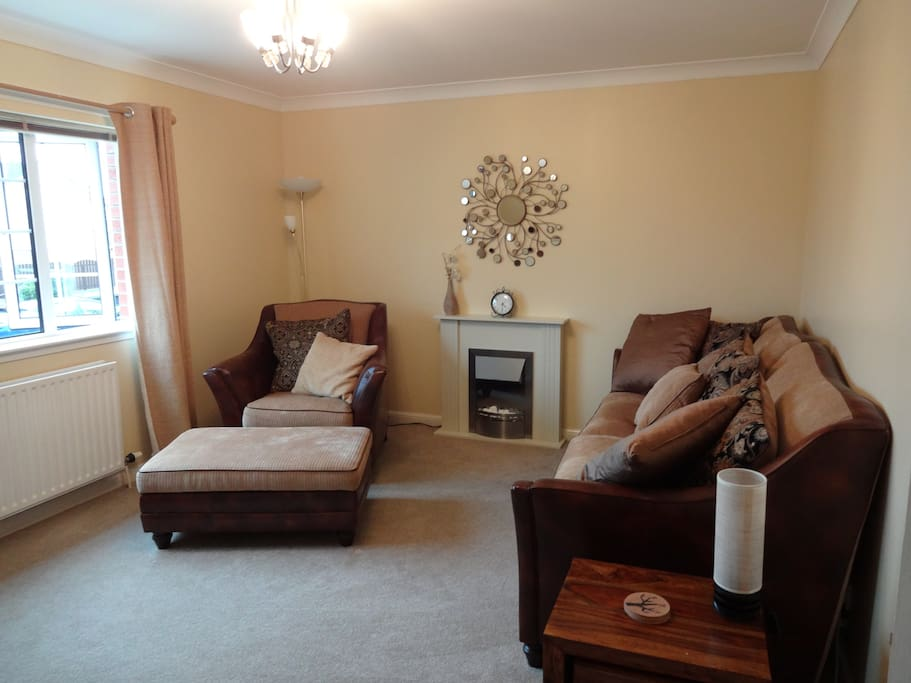 Living room with electric fireplace, flat screen TV, books, DVDs, games, music player, Sky TV, WIFI internet, DVR, central heating.