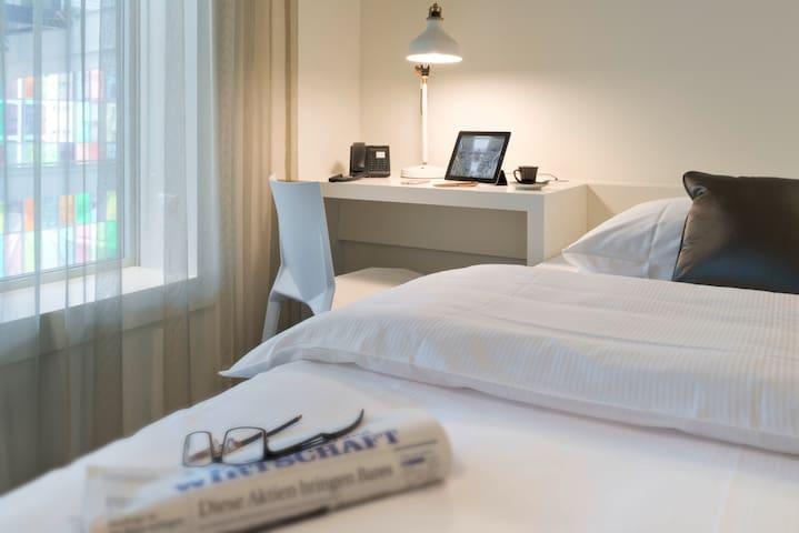 Style Single Room mitten in Baden